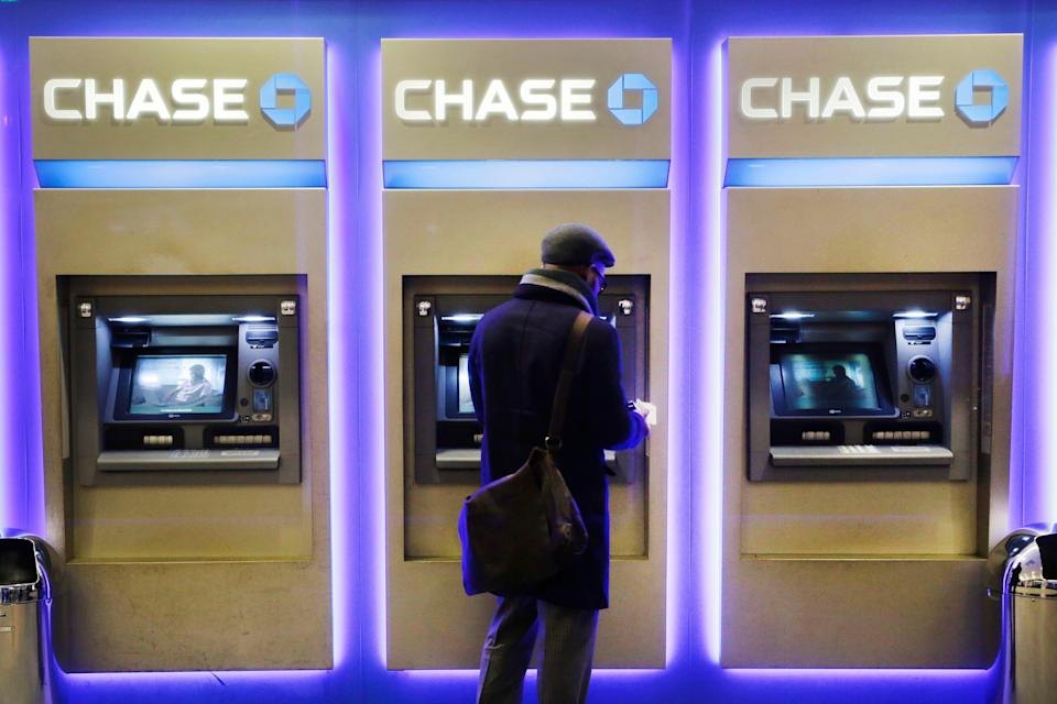 A customer uses an ATM at a branch of Chase Bank, Wednesday, Jan. 14, 2015 in New York.