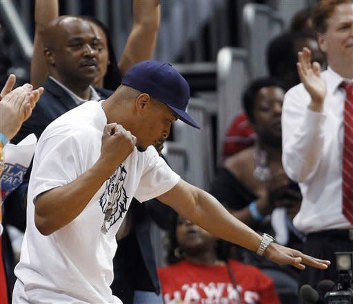 Rapper and actor T.I. reacts as he watches Game 2 of an NBA first-round playoff basketball series between Boston Celtics and the Atlanta Hawks on Tuesday, May 1, 2012, in Atlanta. Boston won 87-80 and evened the series at one game each. (AP Photo/John Bazemore)