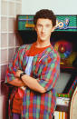 """This 1992 image released by NBC shows actor Dustin Diamond as Samuel Powers, better known as Screech"""" from the series """"Saved by the Bell."""" Diamond died Monday after a three-week fight with carcinoma, according to his representative. He was 44. Diamond was hospitalized last month in Florida and his team disclosed later he had cancer. (Paul Drinkwater/NBCU Photo Bank via AP)"""