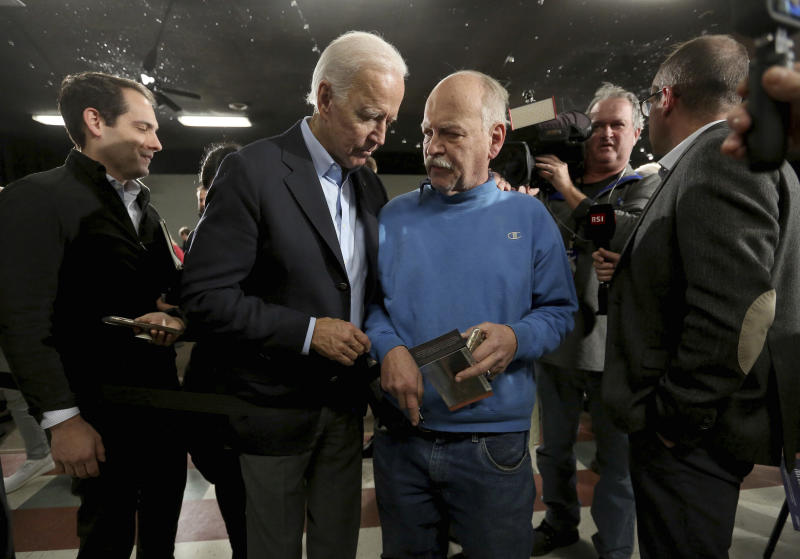 "Democratic presidential candidate and former Vice President Joe Biden greets attendees during his ""No Malarkey"" bus tour at Johnson's Reception Hall in Elkader, Iowa, on Friday, Dec. 6, 2019. (Jessica Reilly/Telegraph Herald via AP)"