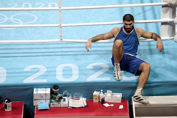 France's Mourad Aliev refuses to leave the ring after being disqualified in his men's super heavyweight quarterfinal bout against Great Britain's Frazer Clarke.