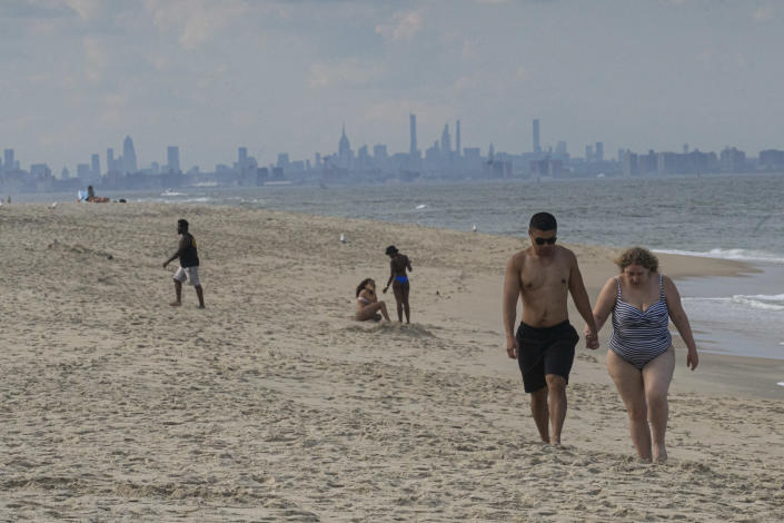 People visit the beach of Sandy Hook in front of the Manhattan skyline on June 26, 2020, in Sandy Hook, New Jersey. (Photo: Kena Betancur/VIEWpress/Corbis via Getty Images)