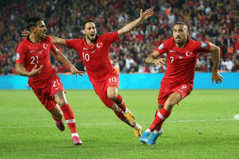 Turkey players reportedly made a military salute after Cenk Tosun (right) scored a last-gasp winning goal in the 1-0 win against Albania on Friday (AFP Photo/-)