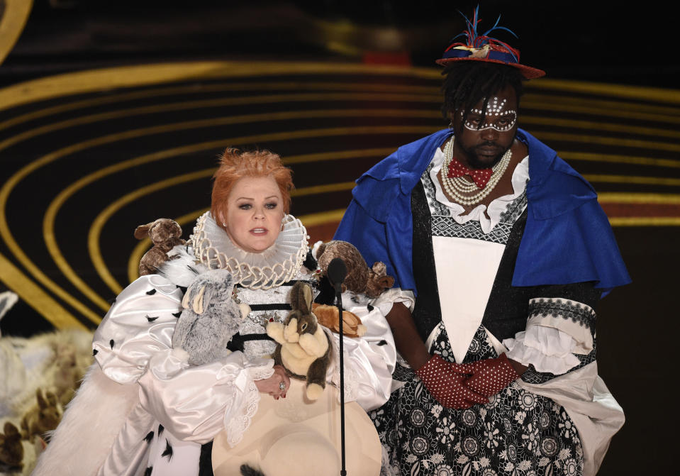 Melissa McCarthy and Brian Tyree Henry present the award for Best Costume Design at the Oscars. (Photo by Chris Pizzello/Invision/AP)