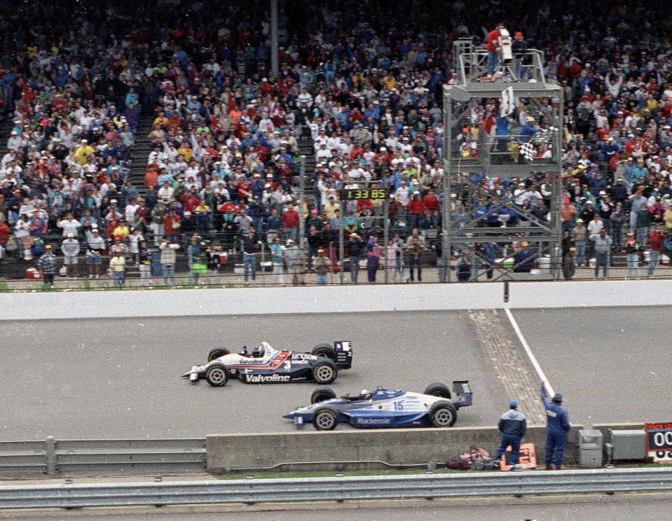 FILE - In this May 24, 1992, file photo, Al Unser Jr., top, wins the Indianapolis 500 auto race by less than a car length ahead of Scott Goodyear in the 76th running of the race at Indianapolis Motor Speedway in Indianapolis. The Associated Press has updated its survey of living Indianapolis 500 winners and their pick as the greatest race in the long history of the event. There are six races that received multiple votes, topped by Unser victory over Goodyear in 1992 the closest Indy 500 in history. The others are Emerson Fittipaldi's win in 1989; Sam Hornish Junior's win in 2006; the 1982 battle between Rick Mears and Gordon Johncock; the 2011 race won by the late Dan Wheldon; and the 2014 thriller won by Ryan Hunter-Reay. (AP Photo/David Boe, File)