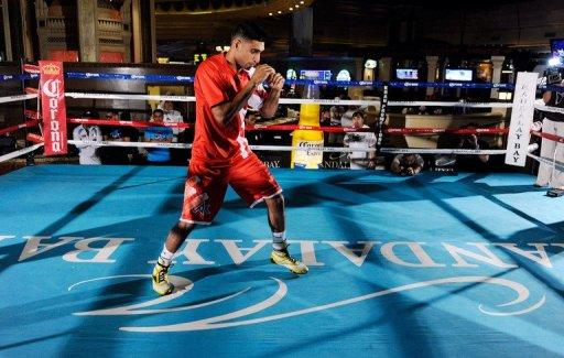 Boxer Amir Khan shadow boxes during a public workout session at the Mandalay Bay Resort & Casino