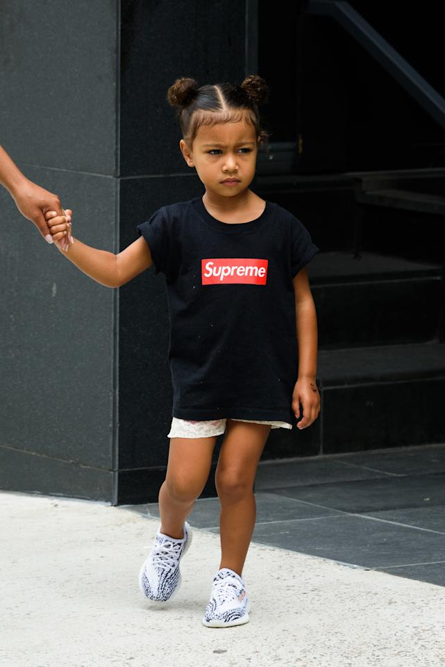<p>The 3-year-old daughter of Kim Kardashian and Kanye West, North West, is often seen wearing Yeezys. She was spotted in New York City wearing a Supreme shirt with the sneakers. (Photo: Splash News) </p>