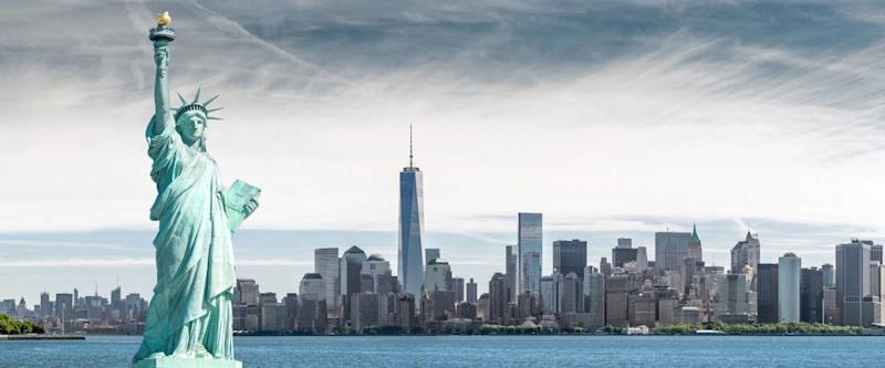 The Statue of Liberty with One World Trade Center background