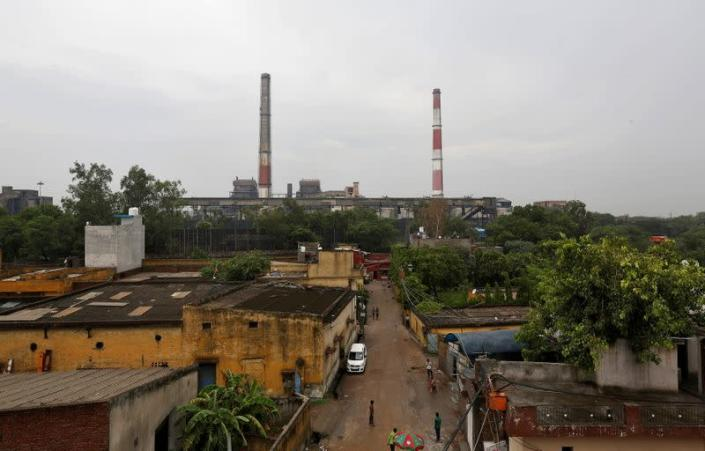 FILE PHOTO: Chimneys of a coal-fired power plant are pictured in New Delhi