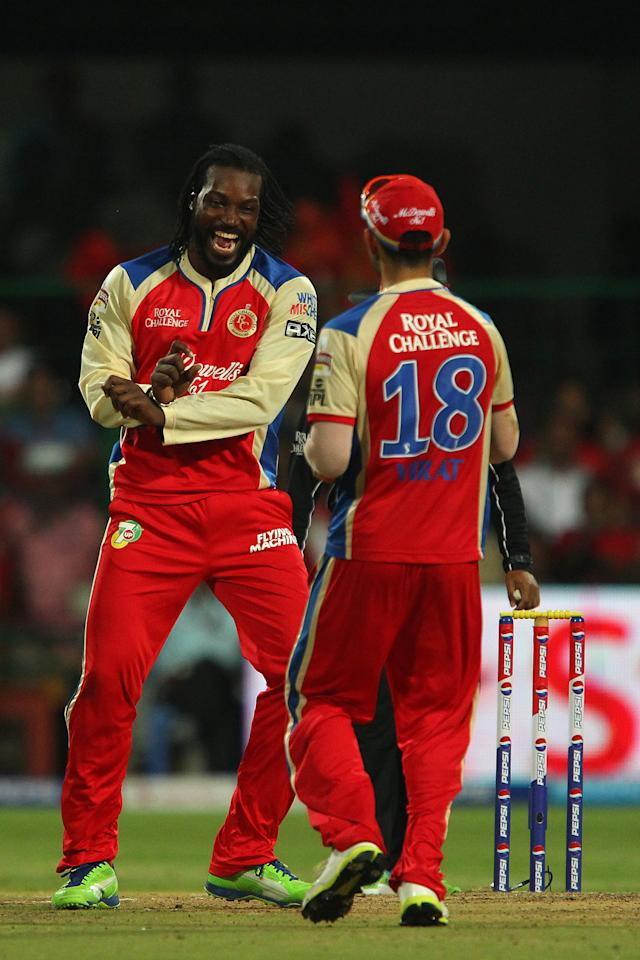 Chris Gayle celebrates the wicket of AG Murtaza during match 31 of the Pepsi Indian Premier League between The Royal Challengers Bangalore and The Pune Warriors India held at the M. Chinnaswamy Stadium, Bengaluru  on the 23rd April 2013..Photo by Ron Gaunt-IPL-SPORTZPICS ..Use of this image is subject to the terms and conditions as outlined by the BCCI. These terms can be found by following this link:..https://ec.yimg.com/ec?url=http%3a%2f%2fwww.sportzpics.co.za%2fimage%2fI0000SoRagM2cIEc&t=1498232793&sig=aANH3wp_UUsBgYPZhpBP.Q--~C