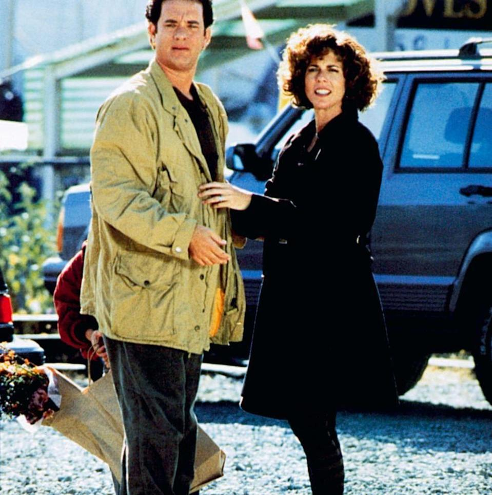 """<p>In the 1993 Nora Ephron <a href=""""https://www.goodhousekeeping.com/life/entertainment/g3243/best-romantic-comedy-movies/"""" rel=""""nofollow noopener"""" target=""""_blank"""" data-ylk=""""slk:romantic-comedy"""" class=""""link rapid-noclick-resp"""">romantic-comedy</a> <em><a href=""""https://www.amazon.com/Sleepless-Seattle-Meg-Ryan/dp/B008Y7GQ72/?tag=syn-yahoo-20&ascsubtag=%5Bartid%7C10055.g.3131%5Bsrc%7Cyahoo-us"""" rel=""""nofollow noopener"""" target=""""_blank"""" data-ylk=""""slk:Sleepless in Seattle"""" class=""""link rapid-noclick-resp"""">Sleepless in Seattle</a></em>, Tom and Rita shared the screen again — this time as best friends. The role was a pivotal point in his career and cemented his status as everybody's favorite guy. """"There are two kinds of romantic leading men in American movies,"""" Nora reportedly <a href=""""https://www.telegraph.co.uk/culture/film/10373074/Tom-Hanks-Is-this-the-most-trusted-man-in-America.html"""" rel=""""nofollow noopener"""" target=""""_blank"""" data-ylk=""""slk:told the Los Angeles Times"""" class=""""link rapid-noclick-resp"""">told the <em>Los Angeles Times</em></a> that year. """"There's the godlike person you've never met, like Cary Grant, and then there's the boy next door you've known all your life, like Jimmy Stewart. Tom falls into the second category.""""</p>"""