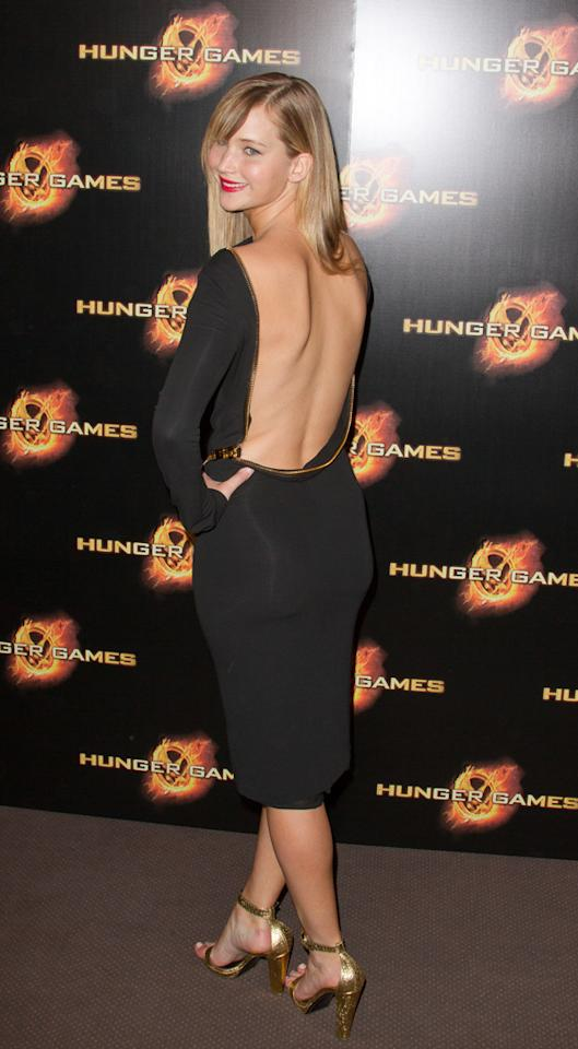 """Jennifer Lawrence attends the """"Hunger Games"""" Paris Premiere photocall at Cinema Gaumont Marignan on March 15, 2012 in Paris, France. (Photo by Marc Piasecki/WireImage)"""