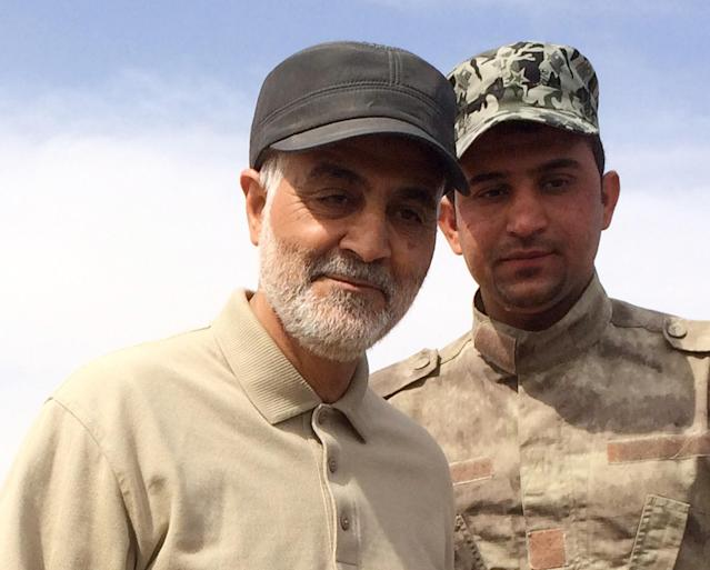Qassem Soleimani (L) in 2015. (REUTERS/Stringer)