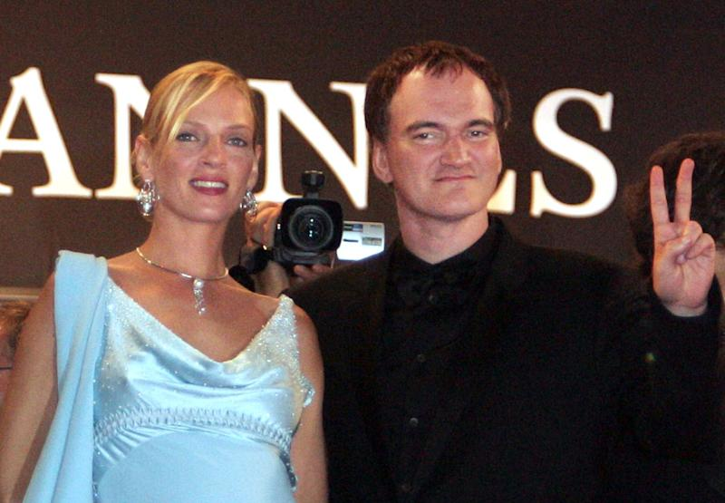 U.S. director Quentin Tarantino (R) gives the 'V' sign as he stands with actress Uma Thurman (R) during red carpet arrivals for the world premier of Tarantino's film, 'Kill Bill Vol. 2' which is screen out of competition at the 57th Cannes Film Festival, May 16, 2004. REUTERS/Vincent Kessler (FRANCE)
