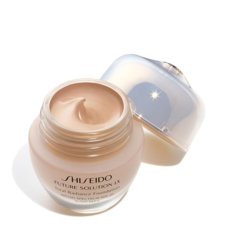 "<p>Vo uses the <a href=""https://www.popsugar.com/buy/Shiseido-Future-Solution-LX-Total-Radiance-Foundation-498487?p_name=Shiseido%20Future%20Solution%20LX%20Total%20Radiance%20Foundation&retailer=shiseido.com&pid=498487&price=92&evar1=bella%3Aus&evar9=46719941&evar98=https%3A%2F%2Fwww.popsugar.com%2Fbeauty%2Fphoto-gallery%2F46719941%2Fimage%2F46721164%2FDewy-Dumpling-Glow-Tip-3-Use-Foundation-As-Concealer&list1=beauty%20products%2Cbeauty%20interview%2Cbeauty%20by%20popsugar&prop13=mobile&pdata=1"" rel=""nofollow"" data-shoppable-link=""1"" target=""_blank"" class=""ga-track"" data-ga-category=""Related"" data-ga-label=""https://www.shiseido.com/future-solution-lx-total-radiance-foundation-spf-20-9990000000150.html"" data-ga-action=""In-Line Links"">Shiseido Future Solution LX Total Radiance Foundation</a> ($92) as a concealer for her under eye circles to keep them looking bright. ""It's almost like a wet second-skin and it doesn't sit in unflattering areas,"" she said. She presses it under her eyes, before setting it with a powder. </p>"