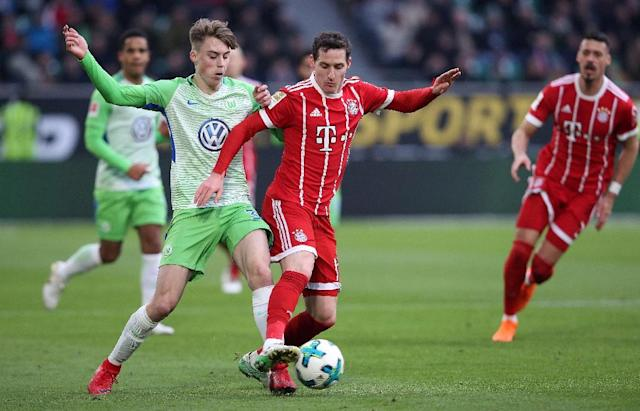 The Bavarians have regained their unyielding grip on first place in Germany, with their 2-1 come-from-behind win at Wolfsburg leaving them 19 points clear at the summit (AFP Photo/Ronny Hartmann)