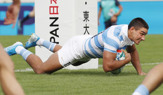 Argentina's Santiago Carreras scores a try during the Rugby World Cup Pool C game at Hanazono Rugby Stadium between Tonga and Argentina in Osaka, Japan, Saturday, Sept. 28, 2019. (Kyodo News via AP)