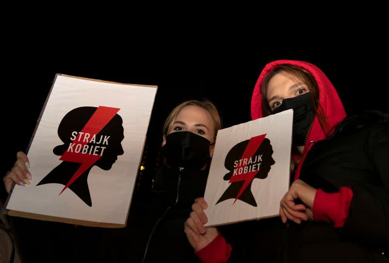 FILE PHOTO: Women hold placards as they take part in a protest against the ruling by Poland's Constitutional Tribunal that imposes a near-total ban on abortion, in Gdansk