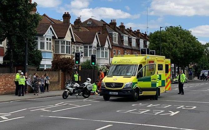 The scene on the Upper Richmond Rd, Richmond London where a police bike, part of a Royal convoy, hit 84 year old Irene Mayor - Simon Banks - The Sun