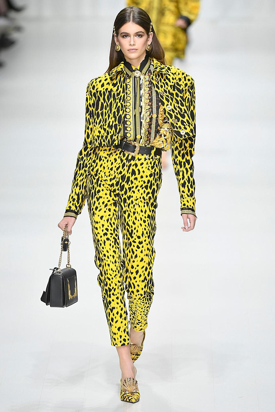 Bright and bold in a head-to-toe yellow printed suit.