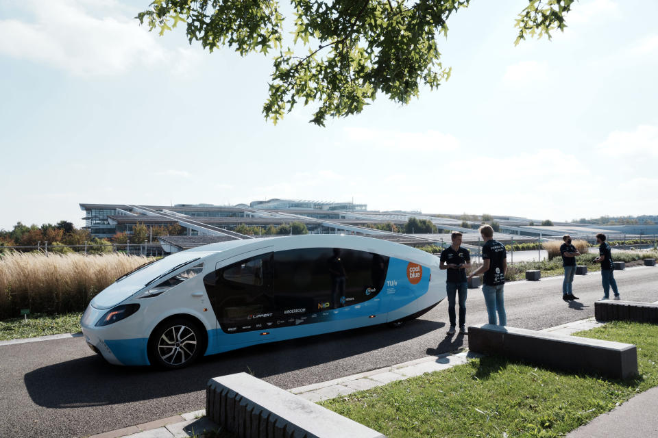 The solar-powered vehicle is on display on a closed road, in Guyancourt, south of Paris, Friday Sept. 24, 2021. A group of Dutch students has reimagined van life and is hitting the road to Portugal. Just don't call their groundbreaking new solar-powered vehicle a campervan. (AP Photo/Thibault Camus)