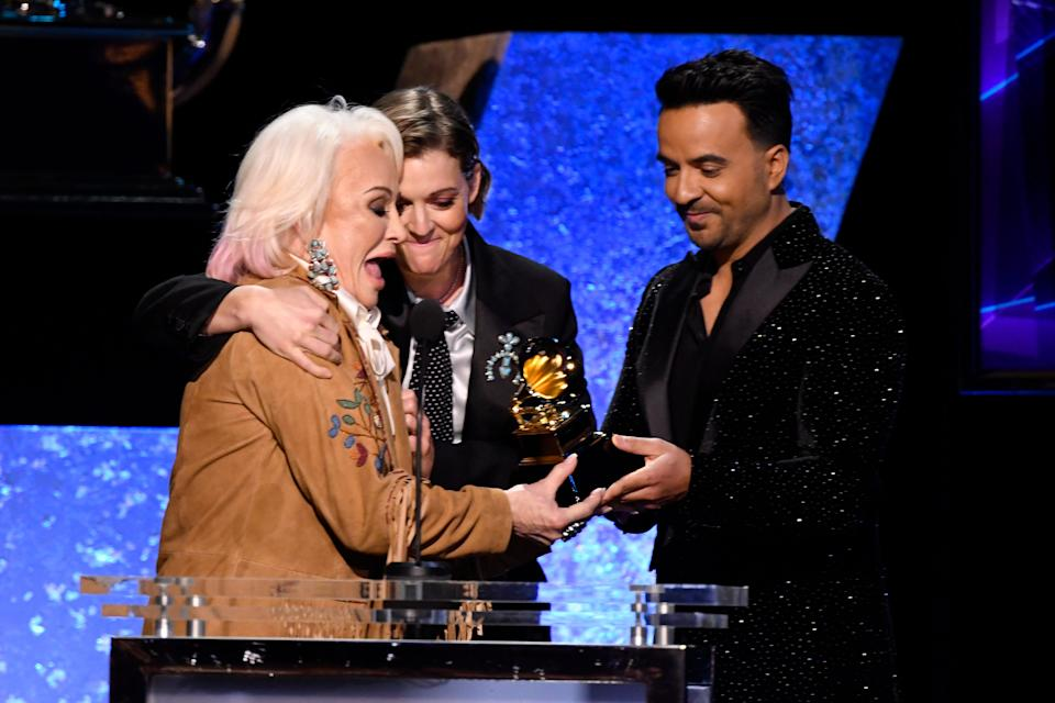 """Tanya Tucker (left)  joined by Brandi Carlile (center) accepts the award for best country album is announced for her album """"While I'm Livin"""" from Luis Fonsi during the 62nd annual Grammy Awards."""
