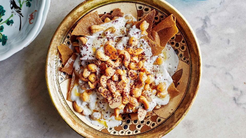 "Typically eaten for breakfast, this creamy, crunchy dish also pairs well with savory dishes come dinnertime. We took a shortcut by using canned chickpeas, which pick up some flavor from a quick simmer with garlic. <a href=""https://www.bonappetit.com/recipe/crispy-pita-with-chickpeas-and-yogurt-fattet-hummus?mbid=synd_yahoo_rss"" rel=""nofollow noopener"" target=""_blank"" data-ylk=""slk:See recipe."" class=""link rapid-noclick-resp"">See recipe.</a>"