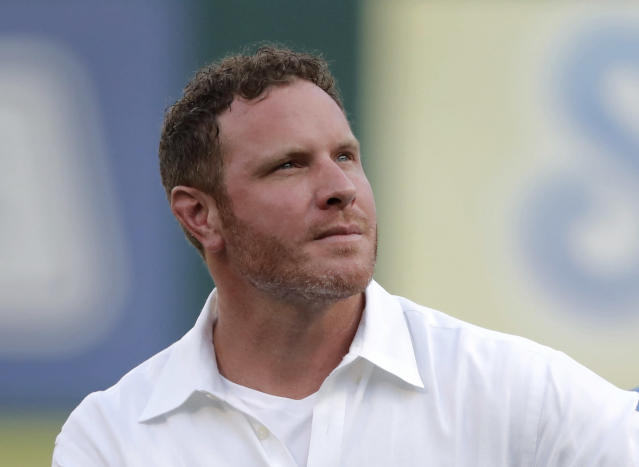 Former player Josh Hamilton participates in a club hall of fame induction ceremony where Hamilton was honored before a baseball game against the Minnesota Twins in Arlington, Texas, Saturday, Aug. 17, 2019. (AP Photo/Tony Gutierrez)