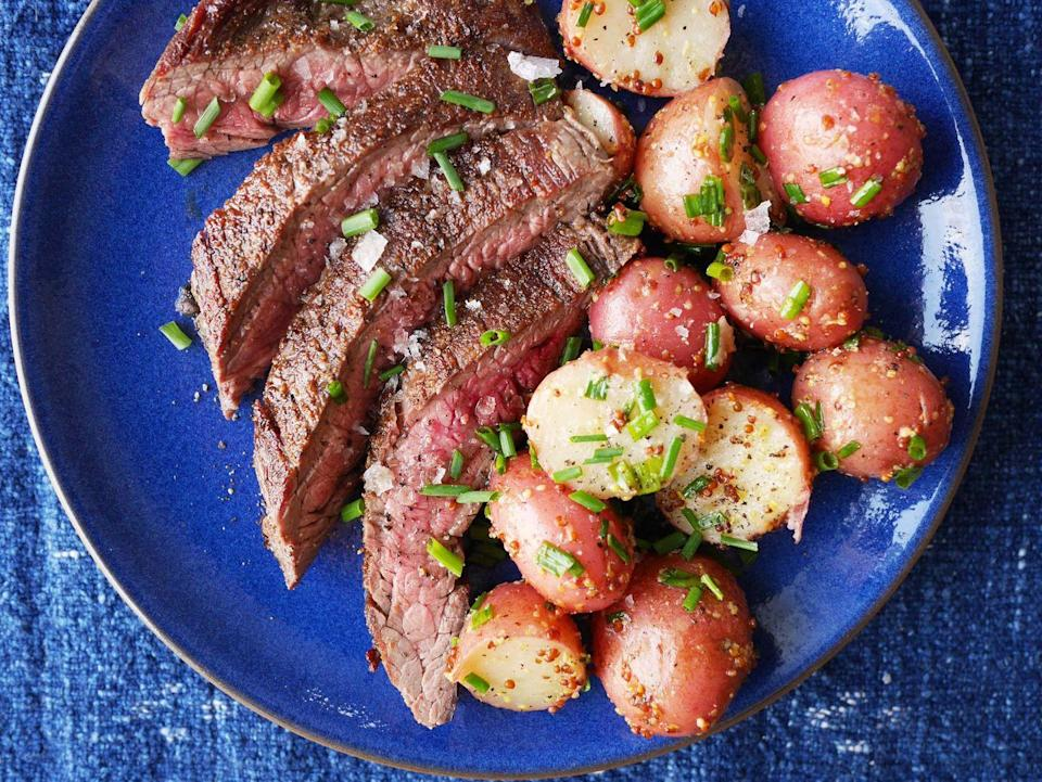 """<p>This grainy mustard potato salad is a delicious side for steak, pork, or chicken.</p><p>Get the recipe from <a href=""""https://www.delish.com/cooking/recipe-ideas/recipes/a42756/best-grilled-flank-steak-potato-salad-recipe/"""" rel=""""nofollow noopener"""" target=""""_blank"""" data-ylk=""""slk:Delish"""" class=""""link rapid-noclick-resp"""">Delish</a>.</p>"""