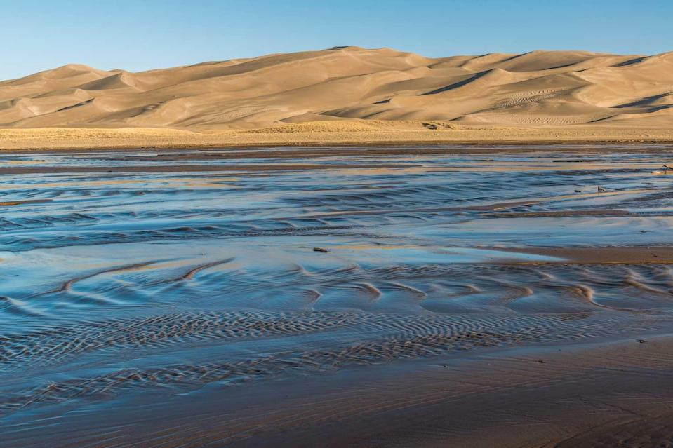 Sand dunes and Medano Creek at sunrise, Great Sand Dunes National Park, Colorado