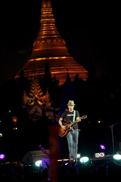 American singer-songwriter Jason Mraz performs at the base of the famous hilltop Shwedagon Pagoda in Yangon, Myanmar, on Sunday, Dec. 16, 2012. Mraz mixed entertainment with education to become the first world-class entertainer in decades to perform in Myanmar, with a concert to raise awareness of human trafficking. (AP Photo/Zin Chit Aung)
