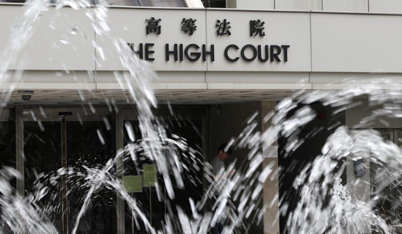 Indonesian maid lifts lid on complicated life of Hong Kong family in yoga ball killings, as pathologist's testimony reduces accused professor to tears