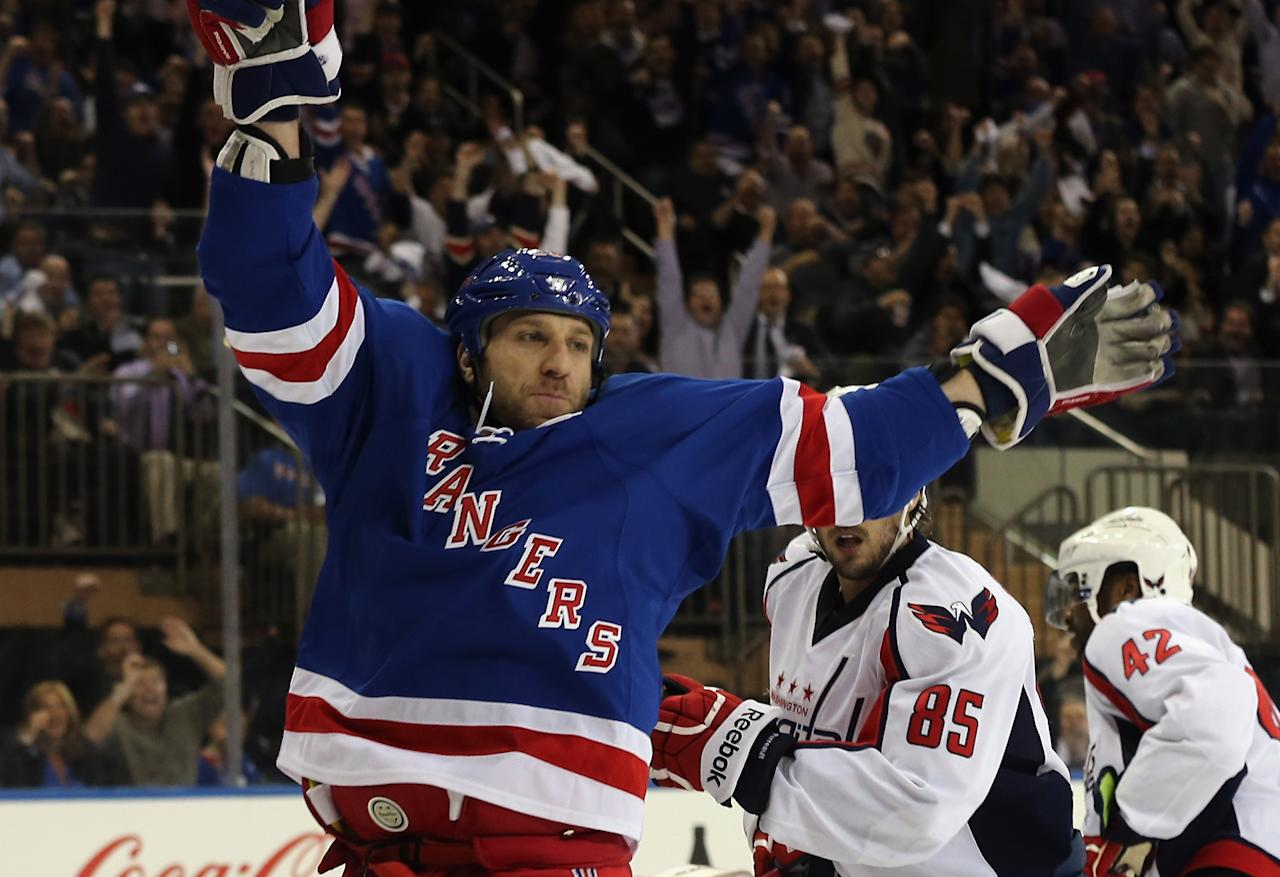 NEW YORK, NY - MAY 08:  Ryane Clowe #29 of the New York Rangers celebrates a goal by Carl Hagelin #62 (not shown) at 10:13 of the second period against the Washington Capitals in Game Four of the Eastern Conference Quarterfinals during the 2013 NHL Stanley Cup Playoffs at Madison Square Garden on May 8, 2013 in New York City.  (Photo by Bruce Bennett/Getty Images)