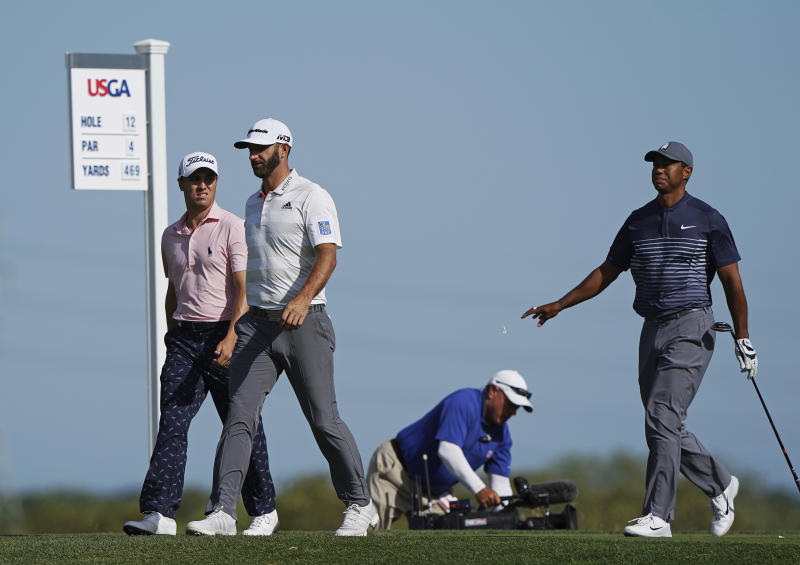 From left, Justin Thomas, Dustin Johnson and Tiger Woods walk off the 12th tee during the first round of the U.S. Open Golf Championship, Thursday, June 14, 2018, in Southampton, N.Y. (AP Photo/Carolyn Kaster)