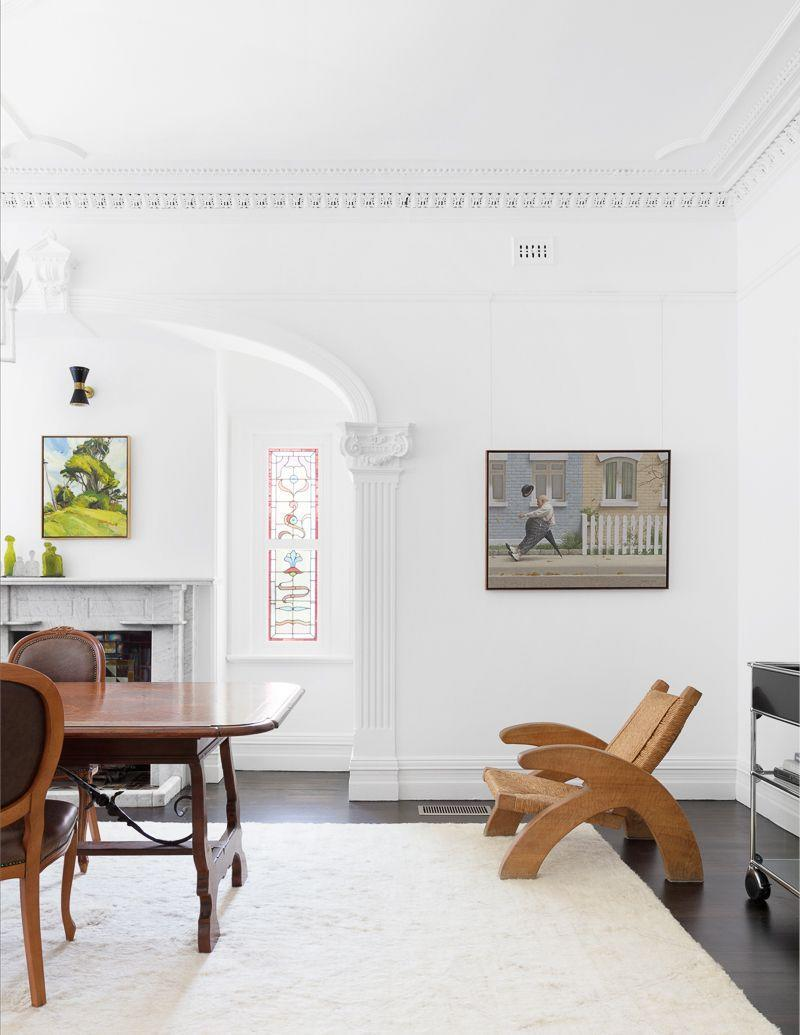 """<p>Traditional stained glass windows pop against the bright white paint in this space by <a href=""""https://apdesignhouse.com.au/"""" rel=""""nofollow noopener"""" target=""""_blank"""" data-ylk=""""slk:AP Design House"""" class=""""link rapid-noclick-resp"""">AP Design House</a>. Modern accent lighting, artwork, and furniture brings the room up to date while still honoring the classic architectural bones of the space. So if you inherited some windows like this and were considering replacing them, allow this example to convince you to preserve them and inject some history. </p>"""