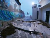 Intense wind and rain caused some damage to structures on the beach in the resort city of Cancun