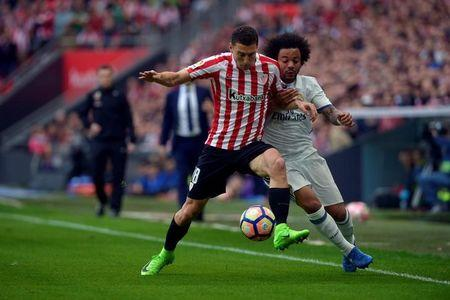 Football Soccer - Real Madrid v Athletic Bilbao- Spanish Liga Santander - San Mames, Bilbao, Spain - 18/03/17 Athletic Bilbao's Oscar de Marcos and Real Madrid's Marcelo Vieira da Silva in action. REUTERS/Vincent West
