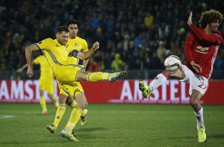 FC Rostov's Aleksandru Gatcan in action with Manchester United's Marouane Fellaini