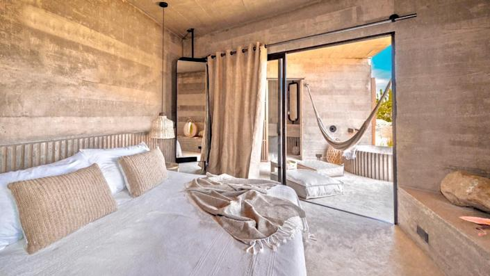 """<p>There's no need to decide between adventure or luxury when booking a stay in Cabo, because <a href=""""https://www.paraderohotels.com/"""" rel=""""nofollow noopener"""" target=""""_blank"""" data-ylk=""""slk:Paradero Todos Santos"""" class=""""link rapid-noclick-resp"""">Paradero Todos Santos</a>, Paradero Hotels's inaugural property, is designed to serve both. This upscale bohemian retreat is created to be a haven for surfers, outdoor enthusiasts, and wellness junkies looking for their perfect slice of paradise. The resort was designed by Mexico City–based Polen, who was behind the landscape design of Google and Twitter's Mexico offices. Paradero Todo Santos will feature a 100,000-square-foot botanical garden alongside sweeping views of the ocean, mountains, and farmlands. You won't want to miss Ojo de Agua, the below-ground spa that is inspired by a secret local watering hole that features centuries-old ingredients and traditions for rejuvenating the mind and body.</p><p><em>Paradero Todos Santos opened in February 2021. Nightly rates start at $550.</em></p>"""
