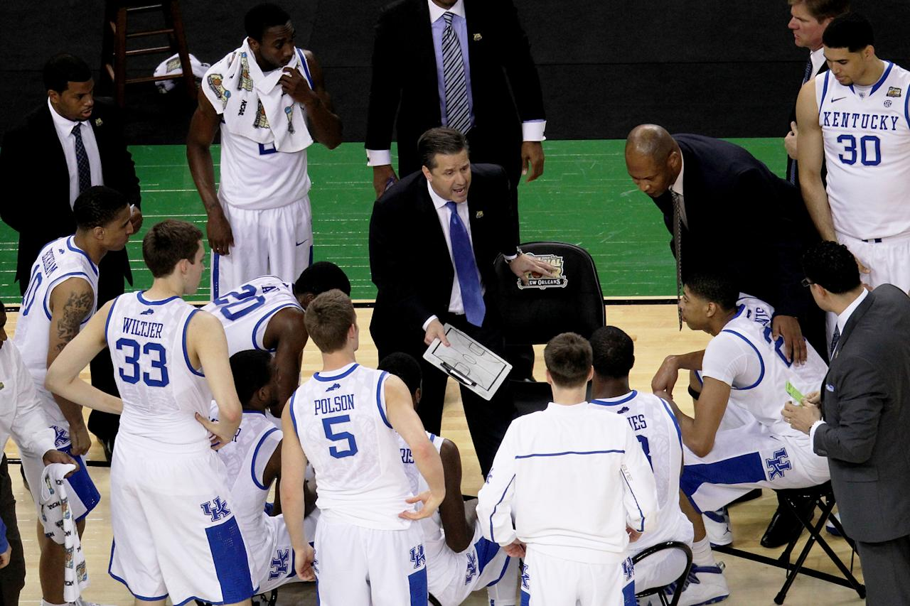Head coach John Calipari of the Kentucky Wildcats talks to his team in the second half while taking on the Kansas Jayhawks in the National Championship Game of the 2012 NCAA Division I Men's Basketball Tournament at the Mercedes-Benz Superdome on April 2, 2012 in New Orleans, Louisiana. (Photo by Chris Graythen/Getty Images)