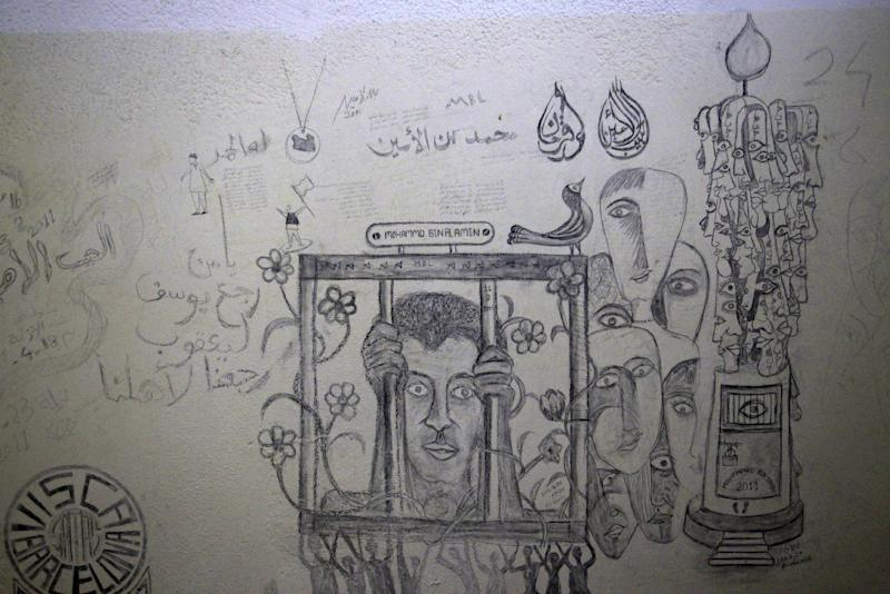 FILE - This Aug. 26, 2011 file photo shows a sketch in one of the cells of the Abu Salim prison in Tripoli, Libya. Abu Salim is one of Libya's most notorious prisons and the scene of a 1996 massacre of prisoners. Human Rights Watch said it has uncovered evidence of a wider use of waterboarding in American interrogations of detainees than has been acknowledged by the United States, in a report Thursday that depicted in unprecedented detail the sweep of abuses in secret prisons under the Bush administration-era U.S. program of detention and rendition of terror suspects. (AP Photo/Sergey Ponomarev, File)