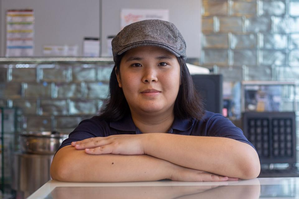 """Jamie Goh, 21, works at the Professor Brawn cafe, which provides on-the-job training for people with autism. She said working at the cafe has helped build her self-confidence through interacting with others. Read our story: <a href=""""https://bit.ly/351P1M4"""" rel=""""nofollow noopener"""" target=""""_blank"""" data-ylk=""""slk:https://bit.ly/351P1M4"""" class=""""link rapid-noclick-resp"""">https://bit.ly/351P1M4</a> (PHOTO: Dhany Osman/Yahoo News Singapore)"""