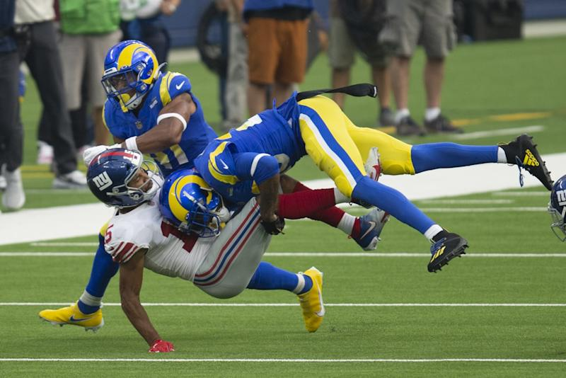 Rams cornerback Jalen Ramsey tackles New York Giants wide receiver Golden Tate.