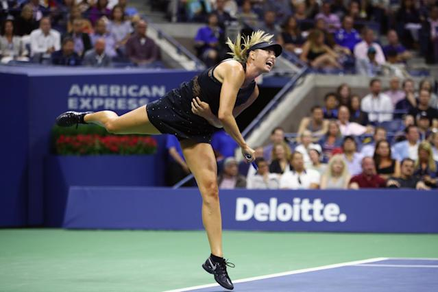 <p>Maria Sharapova of Russia serves during her first round Women's Singles match against Simona Halep of Romania on Day One of the 2017 US Open at the USTA Billie Jean King National Tennis Center on August 28, 2017 in the Flushing neighborhood of the Queens borough of New York City. (Photo by Clive Brunskill/Getty Images) </p>