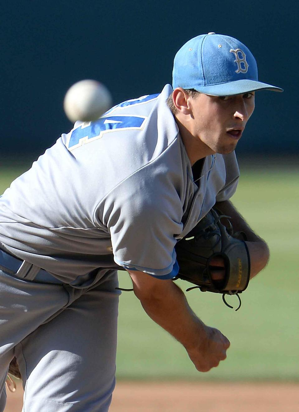UCLA pitcher Cody Poteet throws during the fourth inning against Cal State Bakersfield during an NCAA college baseball tournament regional game in Los Angeles on Sunday, May 31, 2015. (AP Photo/Jayne Kamin-Oncea)