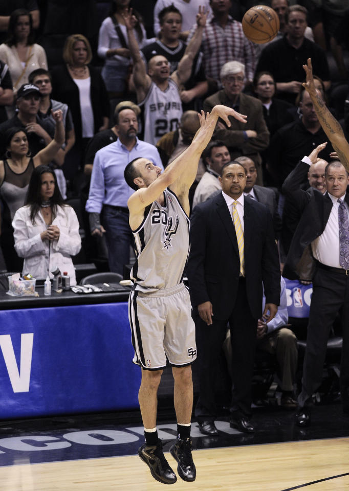 San Antonio Spurs' Manu Ginobili, of Argentina, shoots the game-winning shot during the second overtime of Game 1 of the Western Conference semifinal NBA basketball playoff series against the Golden State Warriors, Monday, May 6, 2013, in San Antonio. San Antonio won 129-127 in double overtime. (AP Photo/Darren Abate)