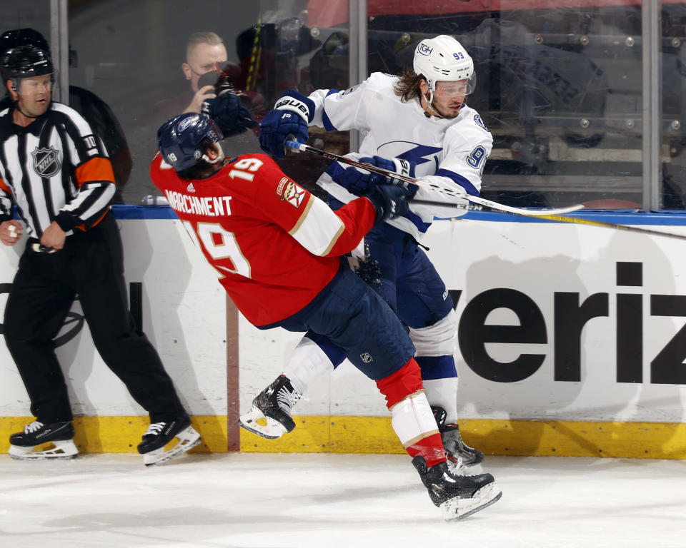 Tampa Bay Lightning center Steven Stamkos (91) checks Florida Panthers left wing Mason Marchment (19) during the third period in Game 1 of an NHL hockey Stanley Cup first-round playoff series, Sunday, May 16, 2021, in Sunrise, Fla. (AP Photo/Joel Auerbach)