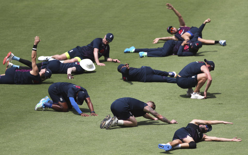 England's cricket team players perform stretching exercises during a training session ahead of the first Twenty20 cricket match between India and England in Ahmedabad, India, Thursday, March 11, 2021. (AP Photo/Aijaz Rahi)