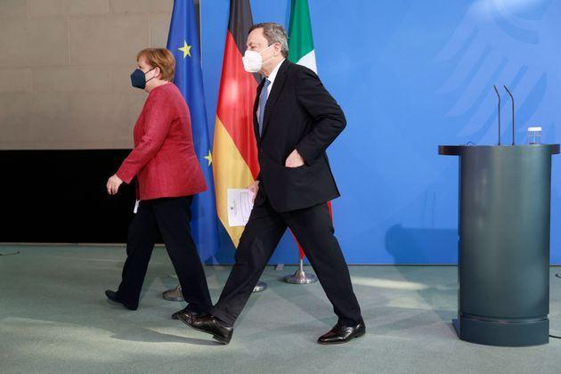 German Chancellor Angela Merkel (L) and Italy's Prime Minister Mario Draghi leave after a press conference after talks ahead of the Euro summit 2021 at the Chancellery in Berlin, on June 21, 2021. (Photo by Odd ANDERSEN / various sources / AFP) (Photo by ODD ANDERSEN/AFP via Getty Images) (Photo: ODD ANDERSEN via Getty Images)