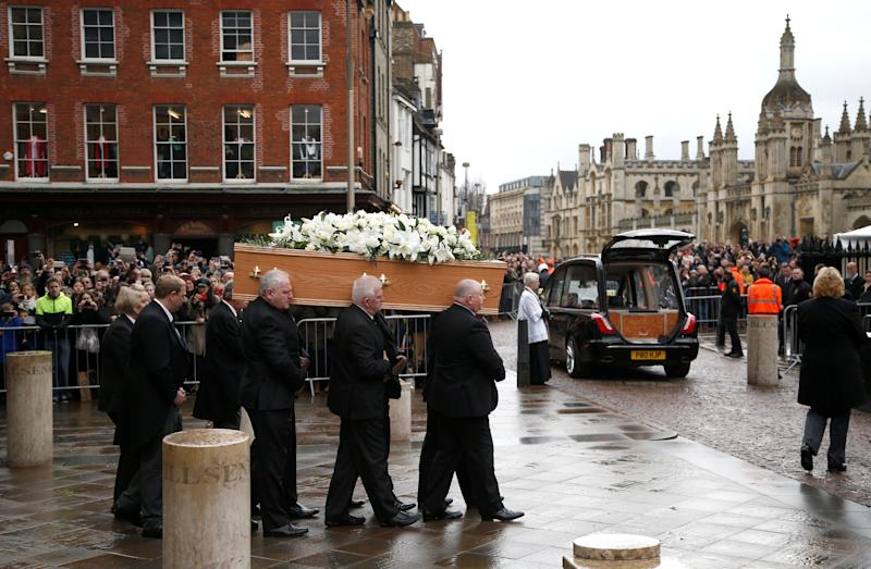 Pallbearers carry the coffin out of Great St Marys Church at the end of the funeral of theoretical physicist Stephen Hawking, in Cambridge, Britain, March 31, 2018.